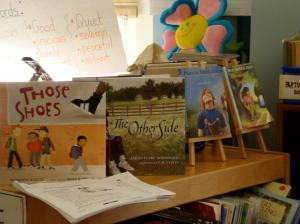 Read aloud titles displayed that reflect students in the class.