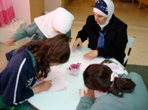 Jumana leads a small group of her writers as they revise personal narratives in Amman.